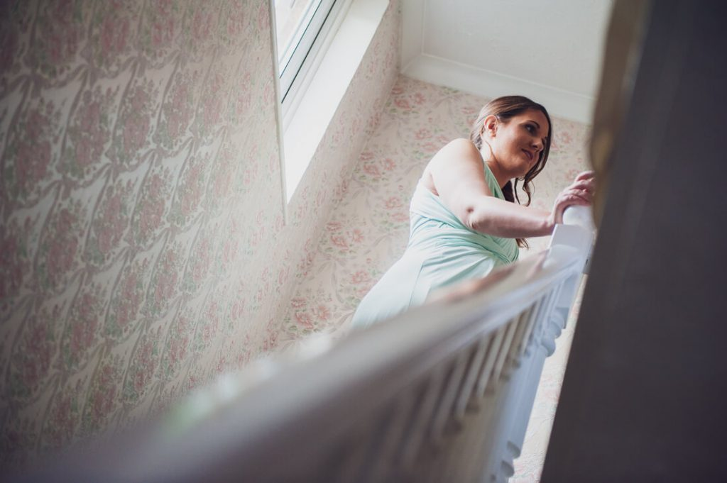 Bridesmaid at the top of the stairs