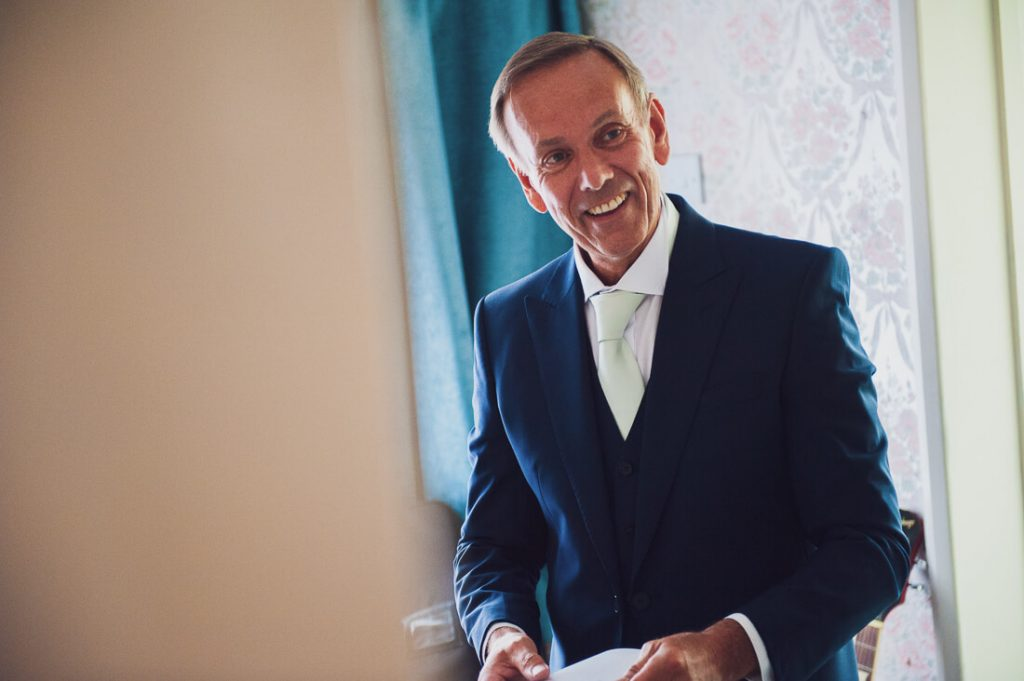 Father of the bride smiling