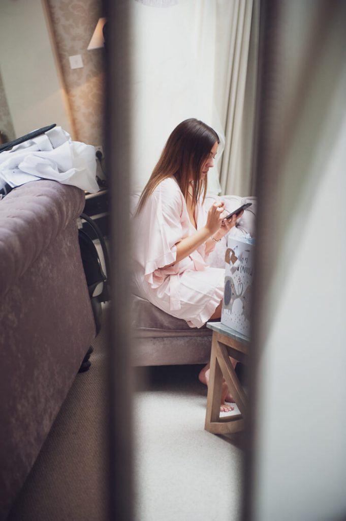 Bridesmaid in mirror texting