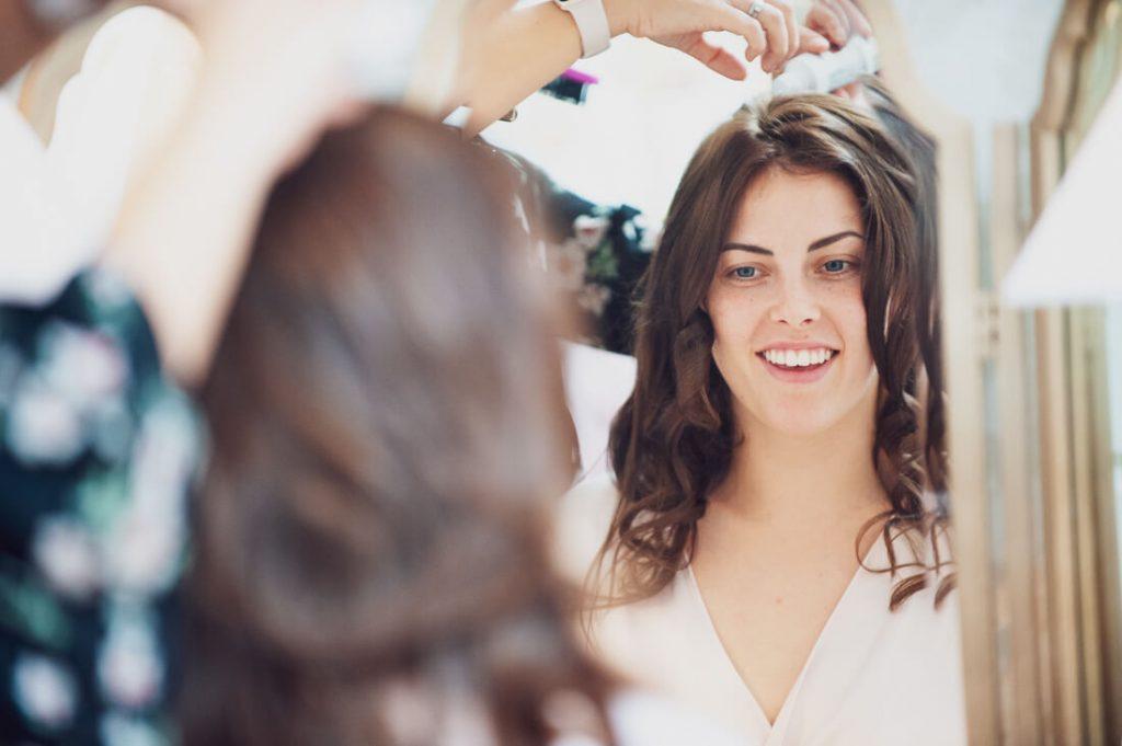 Bridesmaid in makeup chair