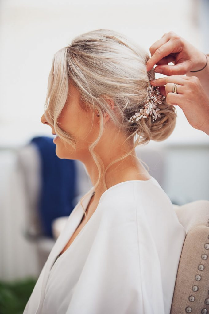 Bride finishing touches to hair