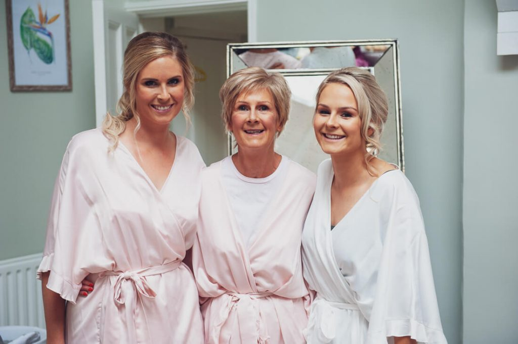 Bride mother and sister smiling