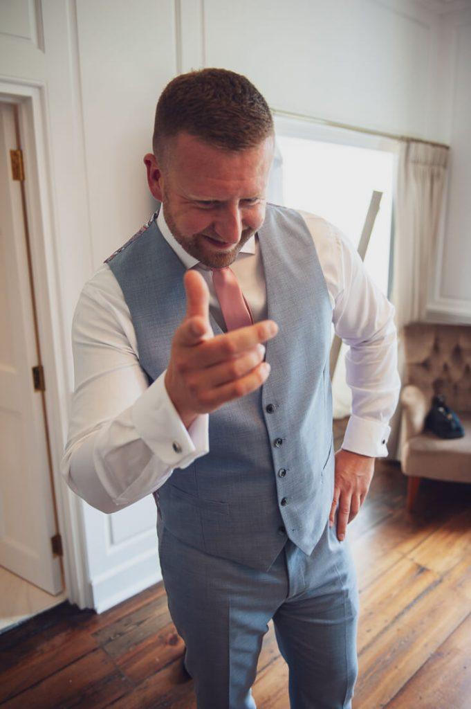 Groom pointing at camera