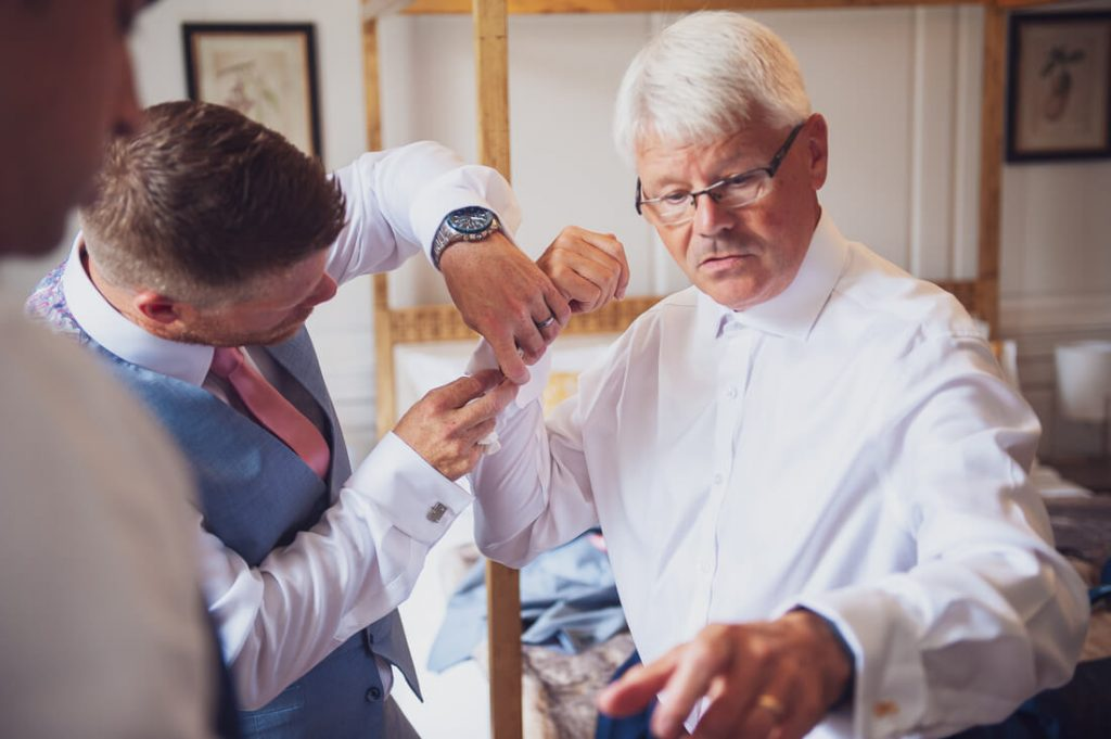 Father of the bride getting ready