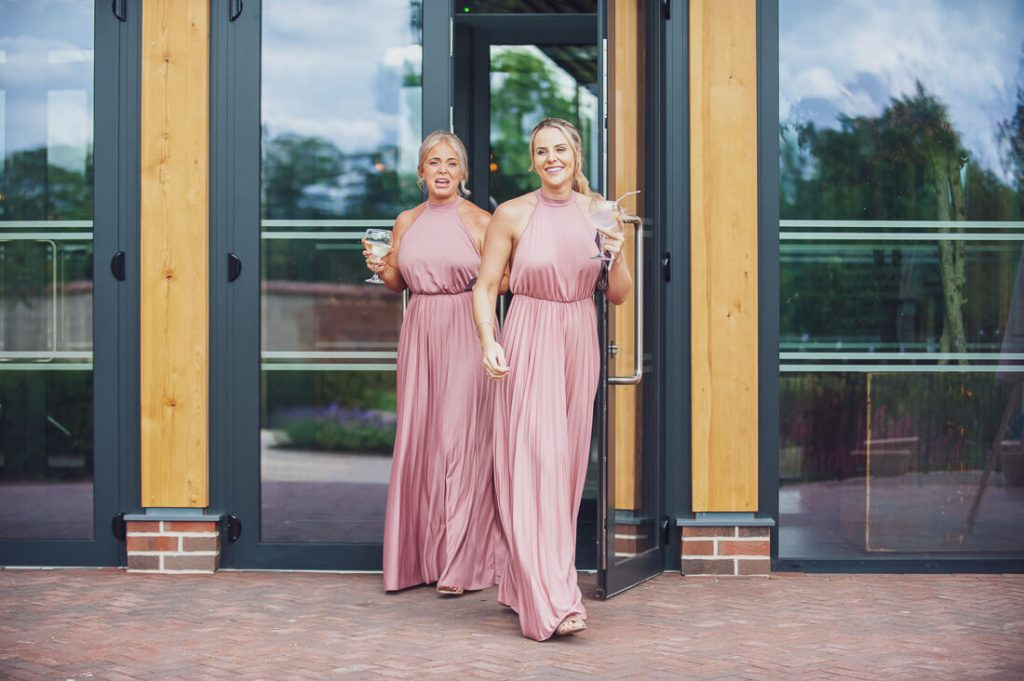 Bridesmaids with drinks in hand