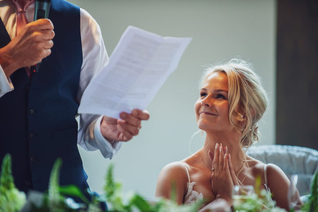 Bride looking at father during speech